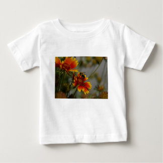 Bee foraging on a flower baby T-Shirt