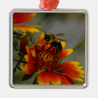 Bee foraging on a flower metal ornament