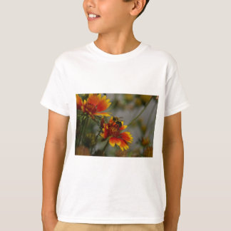 Bee foraging on a flower T-Shirt