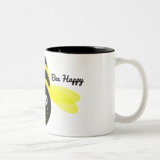 Bee Happy cartoon on a white mug black inside.
