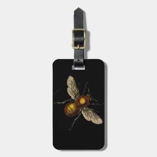 Bee on black luggage tag