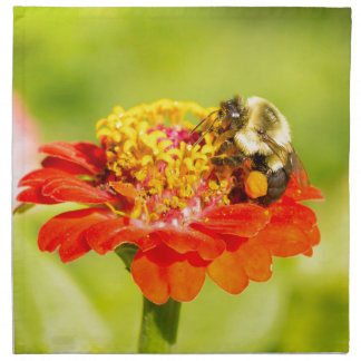 bee on red flower with pollen sacs napkin