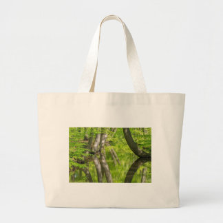 Beech tree trunks with water in spring forest large tote bag