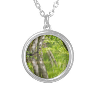 Beech tree trunks with water in spring forest silver plated necklace