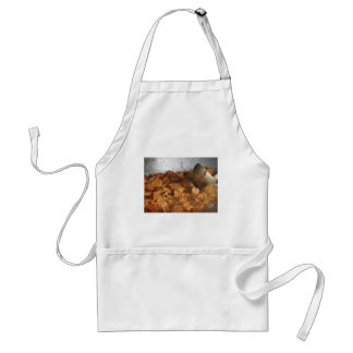 Beef goulash soup with metal serving spoon standard apron