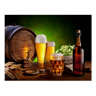 Beer barrel with beer glasses on a wooden table postcard