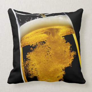 Beer been poured into glass throw pillow
