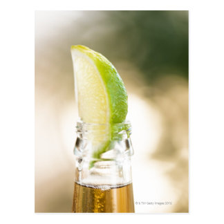 Beer bottle with lime wedge post cards