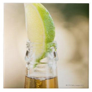 Beer bottle with lime wedge tiles