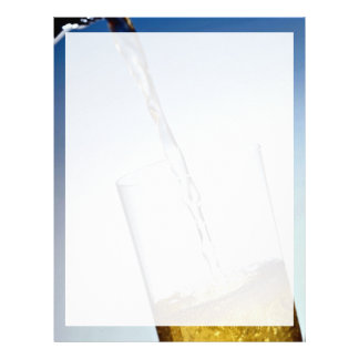 Beer poured into glass letterhead