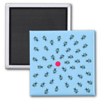 Bees grouping around a red dot square magnet