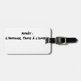 BEFORE: BUSINESS TAPIE IN THE SHADE, AFTERWARDS: LUGGAGE TAG