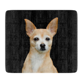 Beige painted chihuahua on black background cutting board