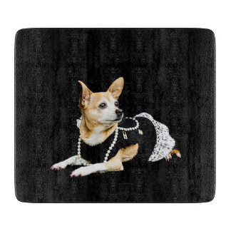 Beige painted glam chihuahua on black background cutting board