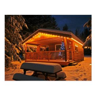 Belles lumières de Noël sur le cabine de rondin Carte Postale