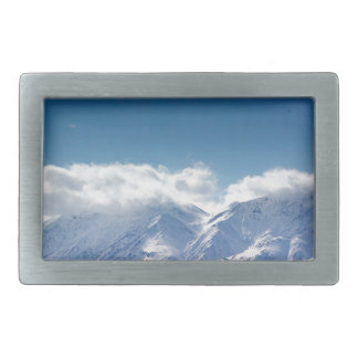 Belt buckle with photo of snowy mountaintop