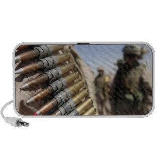 Belts of 50-caliber ammunition notebook speakers