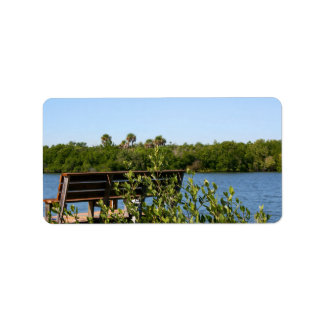 Bench on dock with nature preserve blue sky custom address label