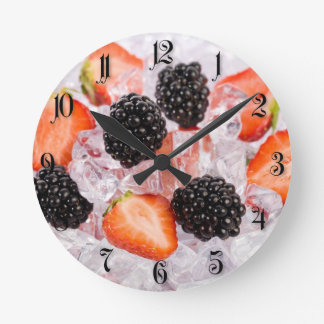 Berries in ice round clock