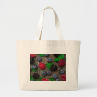 berry fruit background large tote bag