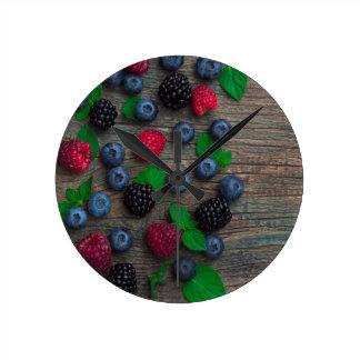 berry fruit background round clock