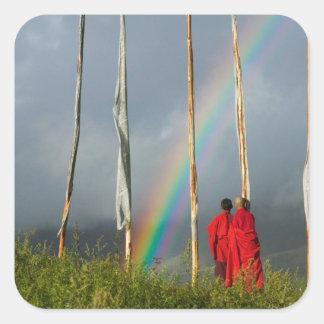 Bhutan, Gangtey village, Rainbow over two monks Square Sticker