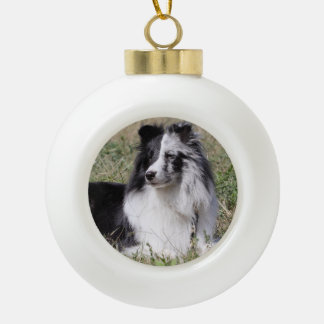Bi Blue Merle Sheltie with Split Face Ceramic Ball Christmas Ornament