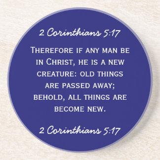 Bible passage 2 Corinthians 5:17 in white text. Coaster