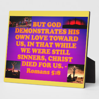 Bible verse from Romans 5:8. Plaque