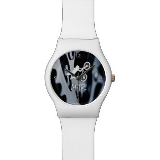 Bicycle gears and bmx stunt with monogram wristwatches
