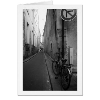Bicycle parked in alley, Paris, France Card