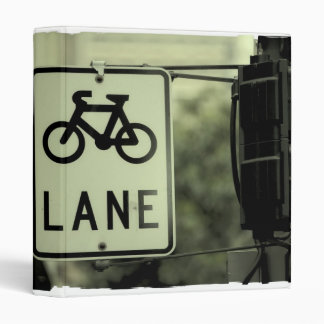 Bicycle sign in the city vinyl binder