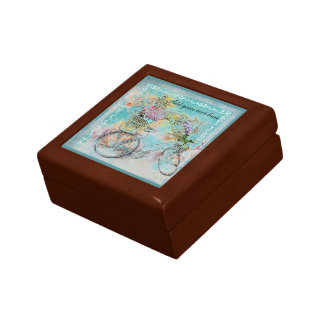 Bicycle with flower baskets on blue burlap gift box