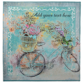 Bicycle with flower baskets on blue burlap napkin