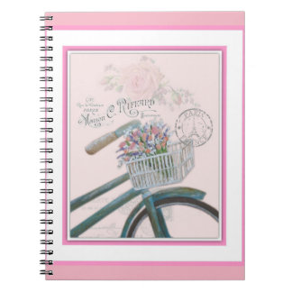Bicycle with flowers on pink background. spiral notebook