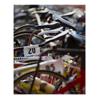 Bicycles on the rack at a triathlon race ready poster