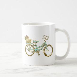 Bicyclette assez bleue avec des tulipes tasse à café
