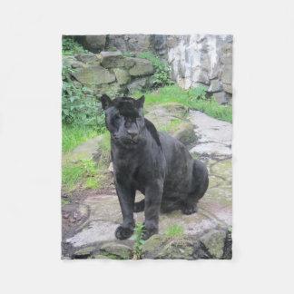 Big Black Jaguar Cat on Sitting on Rock Fleece Blanket