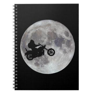 Big foot, big bike and a big bright moon spiral notebook
