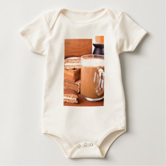 Big mug of hot cocoa with foam baby bodysuit