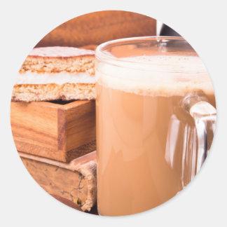 Big mug of hot cocoa with foam classic round sticker