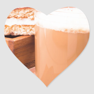 Big mug of hot cocoa with foam heart sticker