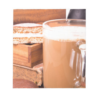 Big mug of hot cocoa with foam notepad