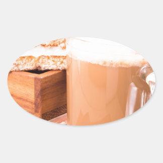 Big mug of hot cocoa with foam oval sticker