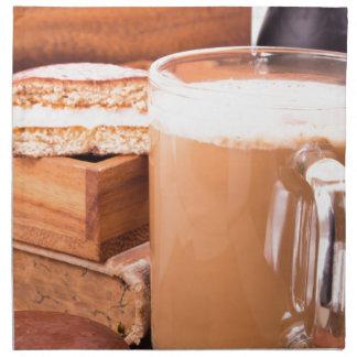 Big mug of hot cocoa with foam printed napkins