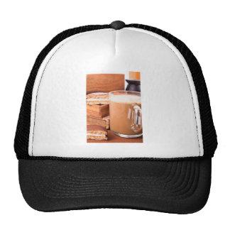Big mug of hot cocoa with foam trucker hat