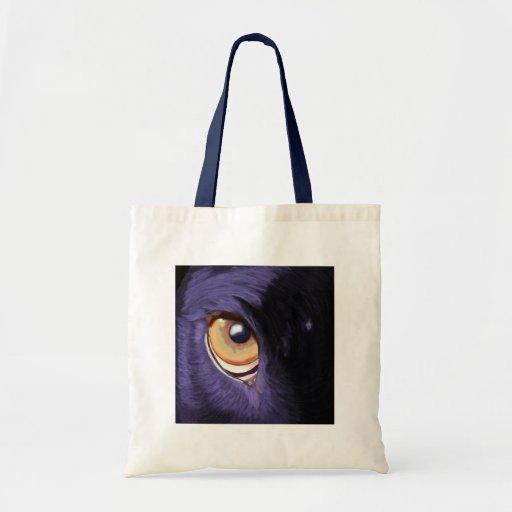 Big Penetrating Orange Eye on Blue Fur Tote Bags