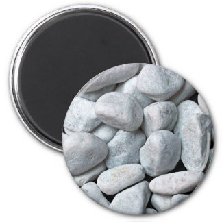 Big pile of gray and white stones from the beach 2 inch round magnet