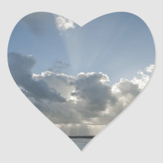 Big rays through clouds heart sticker