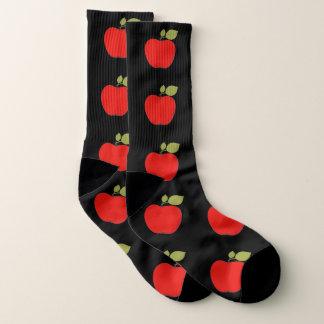 Big red apples with leaves on black patterned socks